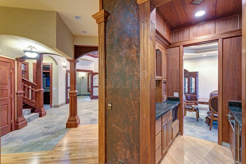 Wedding venue interior. U-shaped wet bar with paneled walls. Wedding venue interior features U-shaped wet bar with paneled walls and cabinets with granite royalty free stock image
