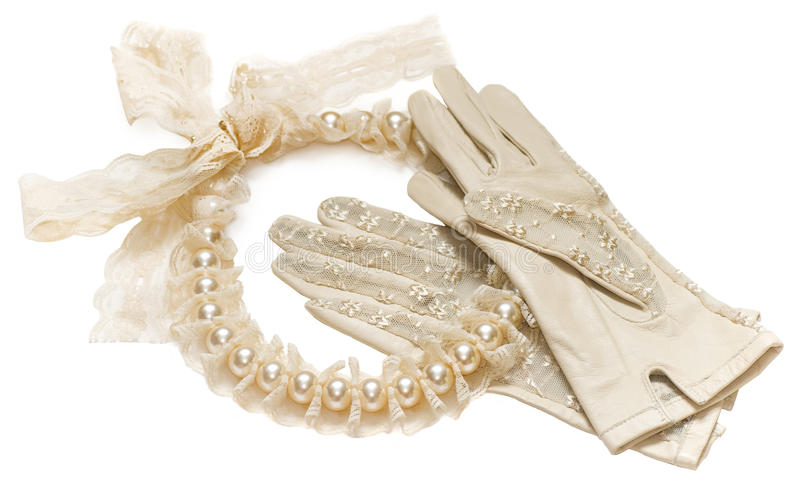 Wedding vintage accessories. Isolated on white, bridal wedding retro vintage accessories, beige nude antique lace with pearles, beige nude lace gloves, pearl stock images