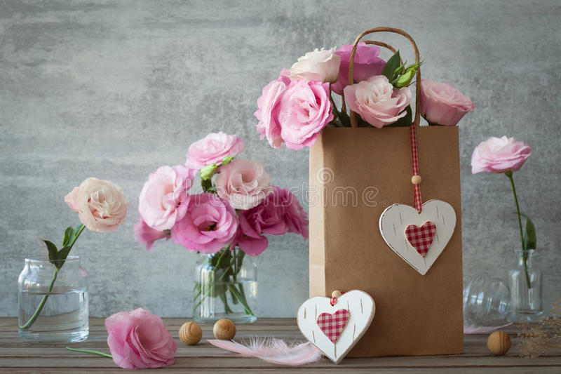 Wedding vintage background with pink flowers and hearts stock image