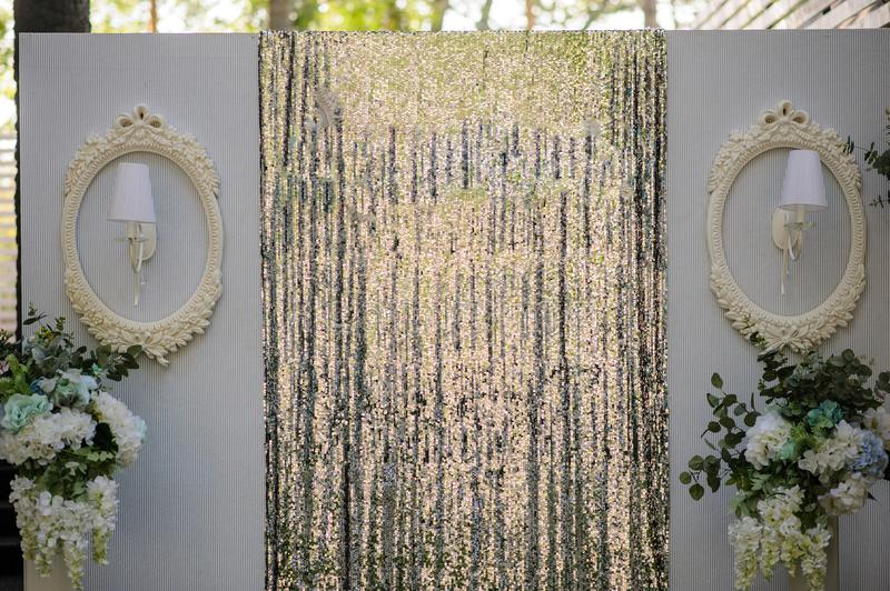 Wedding Wall for photo session decoration outdoor. Vintage metallic style, flowers decoration from: roses, hortensia and ranunculus. Paper origami composition stock photography