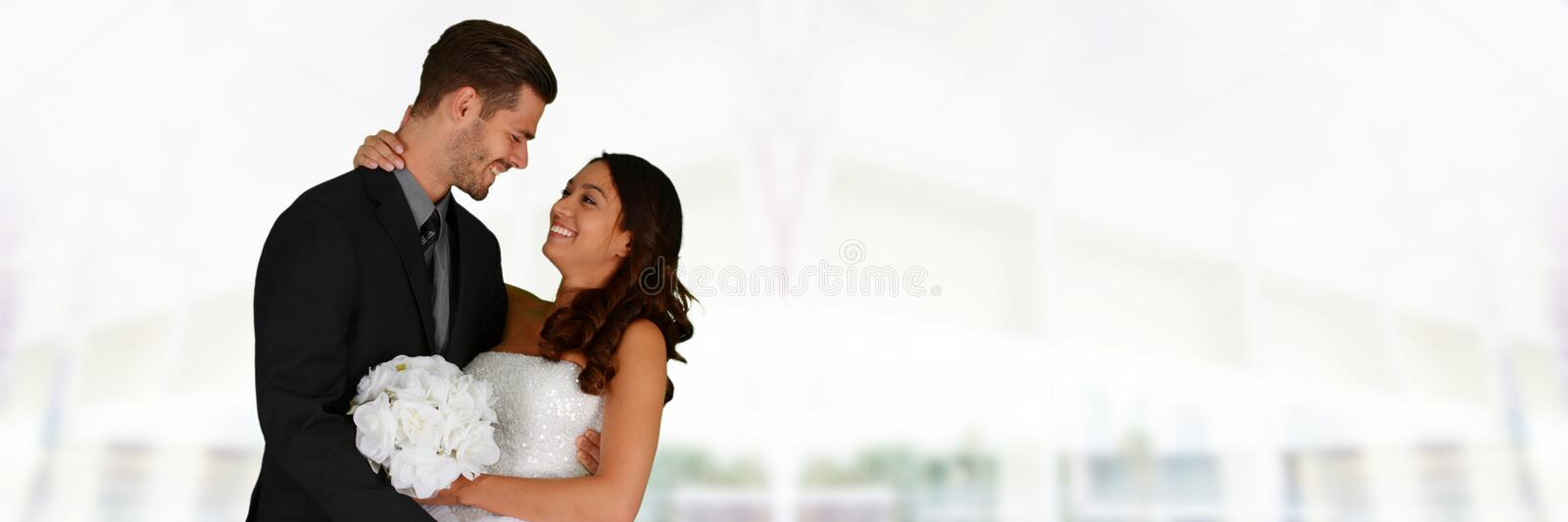 Wedding. Woman in a beautiful white wedding dress with groom royalty free stock images