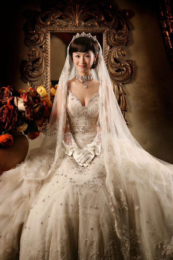 Wedding woman portrait. Young wedding woman portrait. On ancient mirror background royalty free stock image