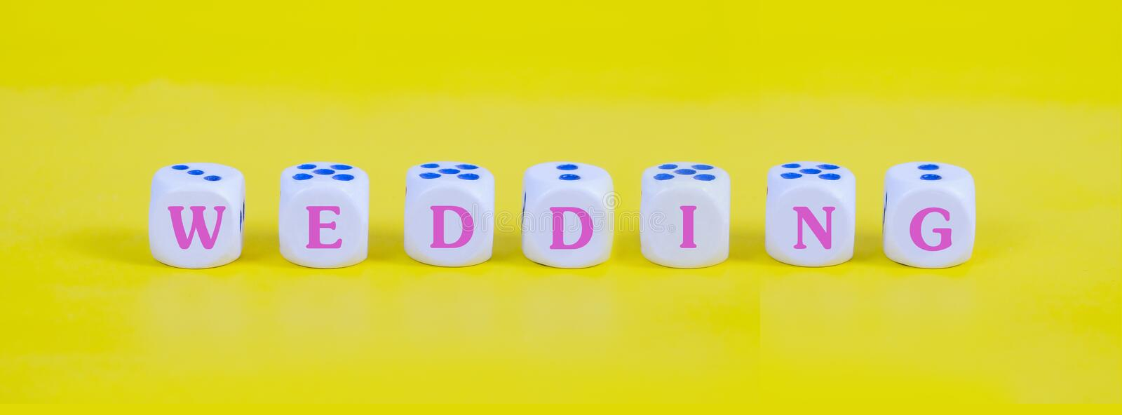 Wedding word on white dice on color background, royalty free stock image