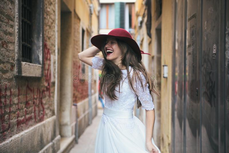 Wedding. Young european bride is walking in Venice. Italy royalty free stock image
