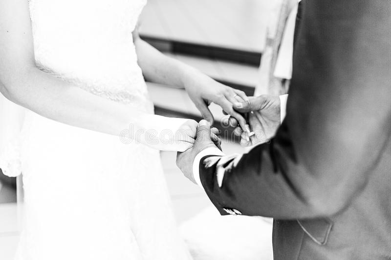 Weddings man holding wife hands stock images