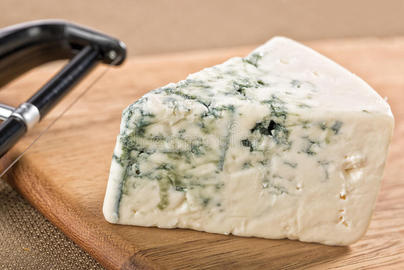 Wedge of creamy delicious gorgonzola blue cheese stock photo