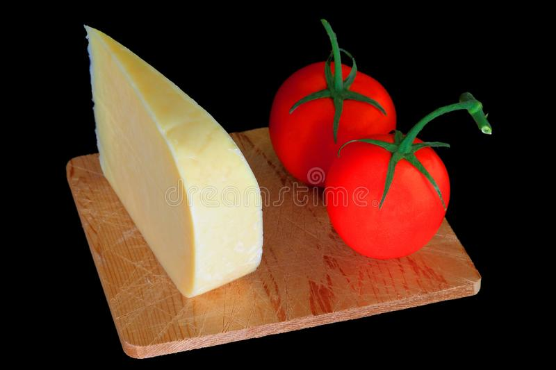 Wedge Smocked Gouda Cheese and Organic Tomatoes royalty free stock image