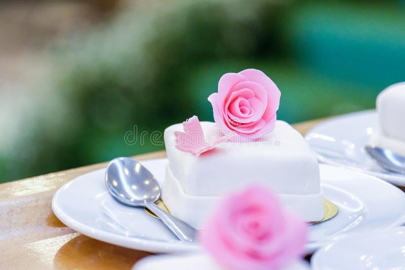 White cupcakes decorated with pink flowers. Weding white cupcakes decorated with pink flowers royalty free stock photo