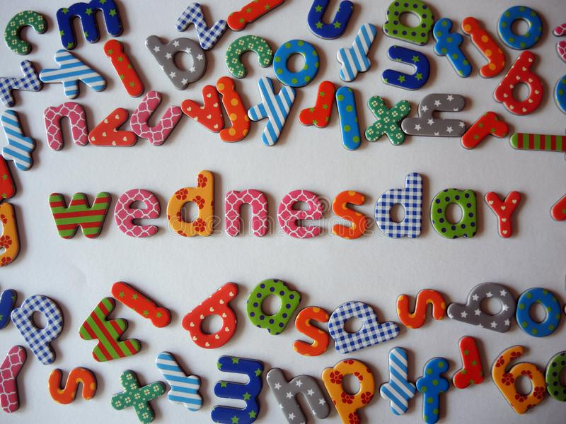 Wednesday banner with colorful lower case letters stock images