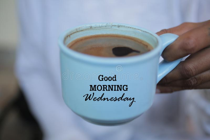Cup of coffee. Good morning Wednesday greeting on cup of coffee. Morning coffee concept. royalty free stock image