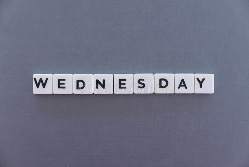 Wednesday word made of square letter word on grey background royalty free stock photography