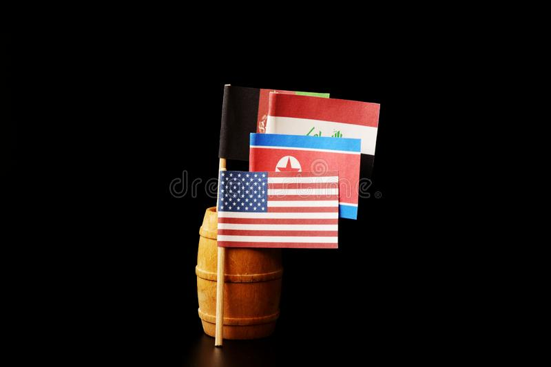 Wee see flags of states where america using their soldiers. Afghanistan, Iraq and North Korea where it is on edge. Black background stock image