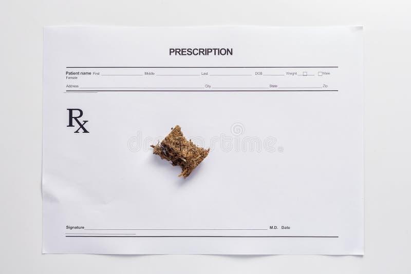 Weed marijuana hashish prescription paper. White background herb health medicine alternative stock image