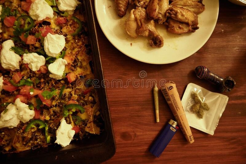 Weed at Super Bowl Party with Nachos and Wings. Weed at Super Bowl Party with nachos, wings and friends royalty free stock image