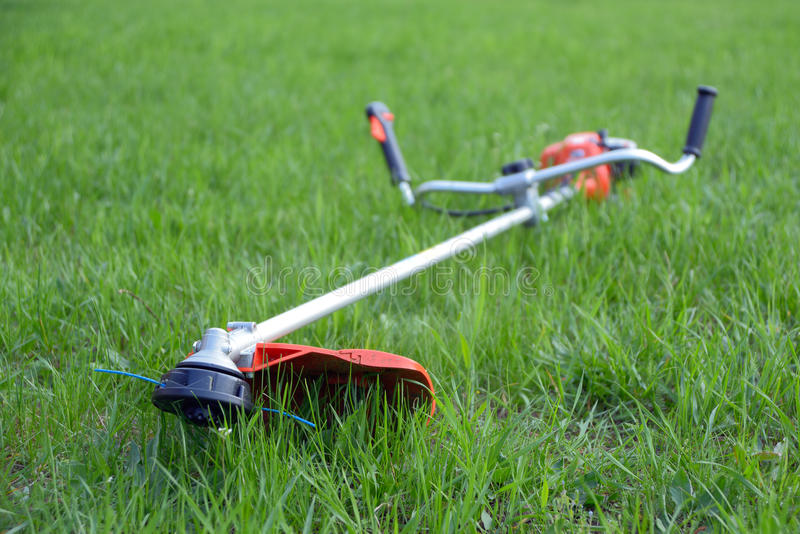 Weed trimmer. On the lawn, focus foreground stock photos