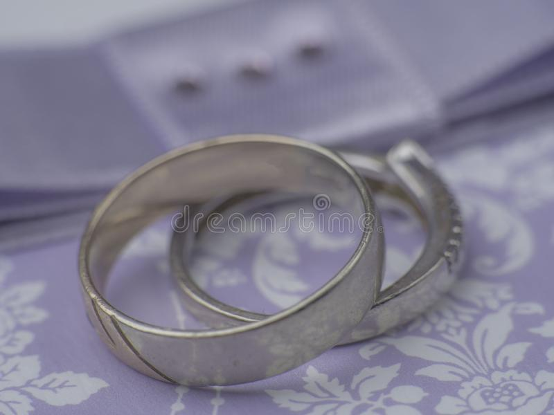 Weeding postcard with rings on purple background, blurred. Card royalty free stock image