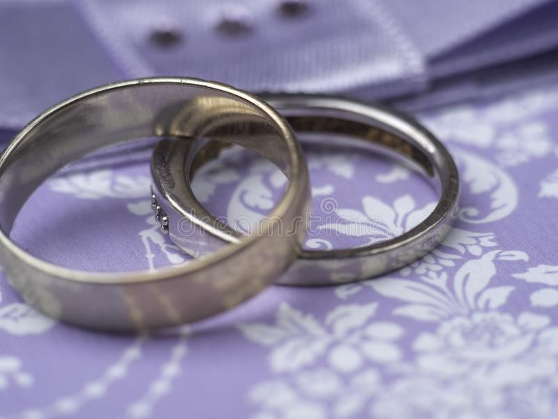 Weeding postcard with rings on purple background, blurred. Card stock photography