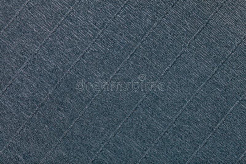 Weefsel van donkergrijze achtergrond van golvend golfdocument, close-up royalty-vrije stock afbeelding