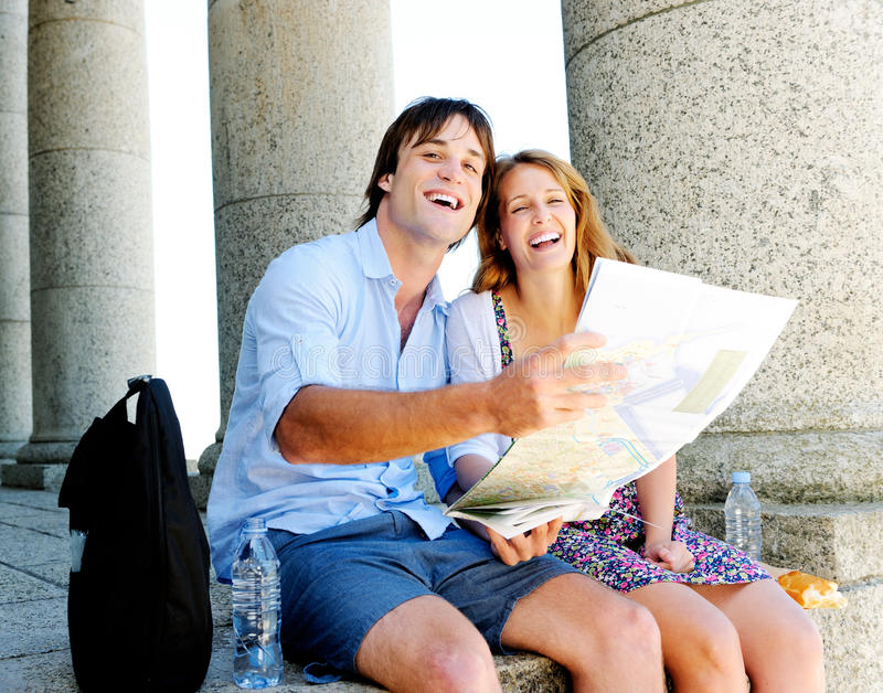 Weekend getaway. Happy couple on holiday, holding a map stock photo