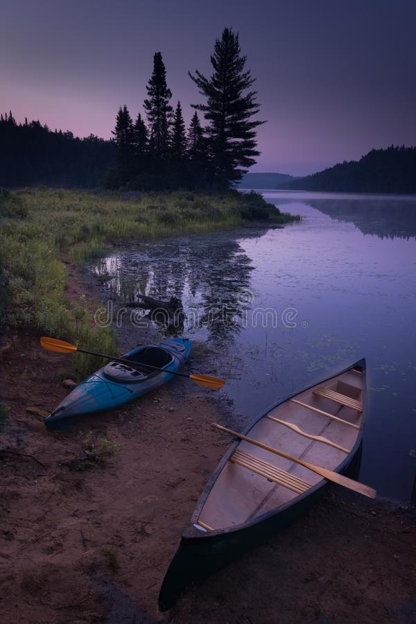 Weekend kayak-canoe camping with the kids.  royalty free stock images
