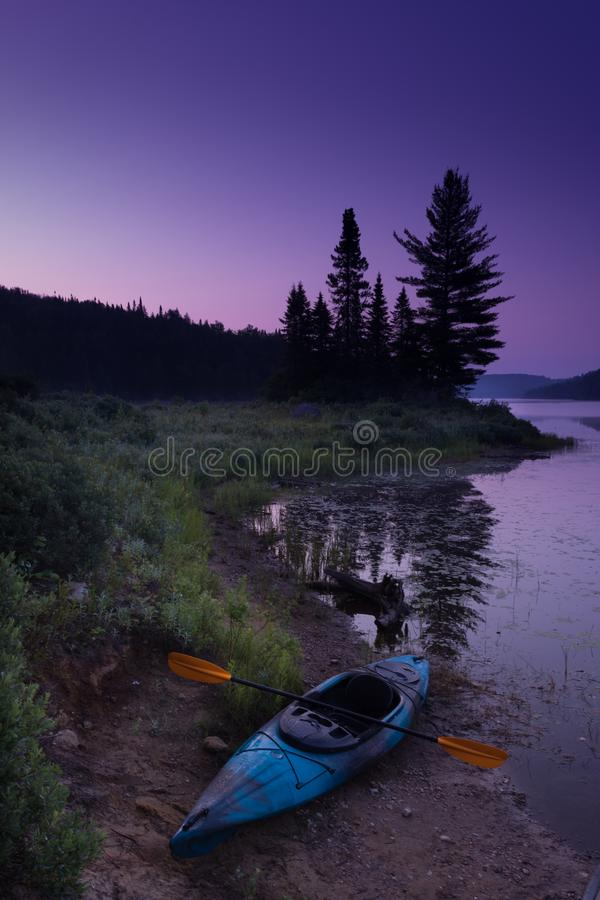 Weekend kayak-canoe camping with the kids.  stock photography