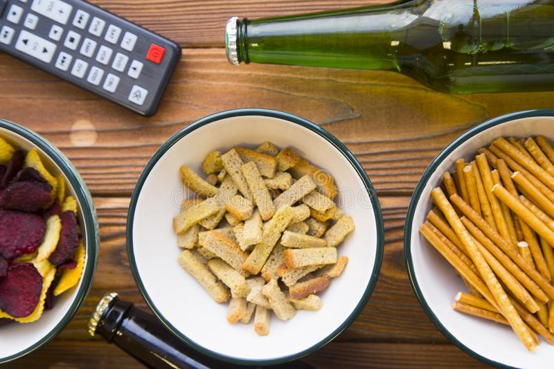 Snacks, beer and remote control stock photos