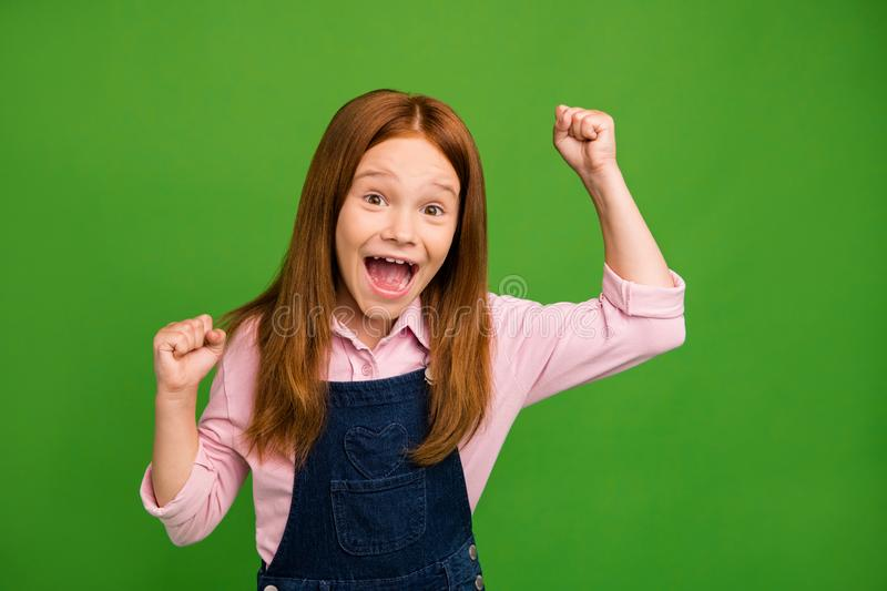 Weekend. Photo of little ginger schoolchild in front of blackboard celebrating final examination best result in class. Weekend. Photo of little ginger royalty free stock photos