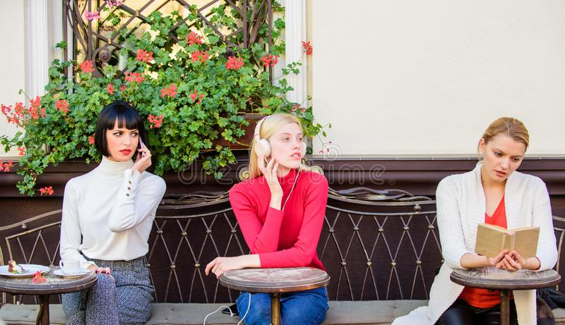 Weekend relax and leisure. Hobby and leisure. Different interests. Group pretty women cafe terrace entertain themselves stock photos