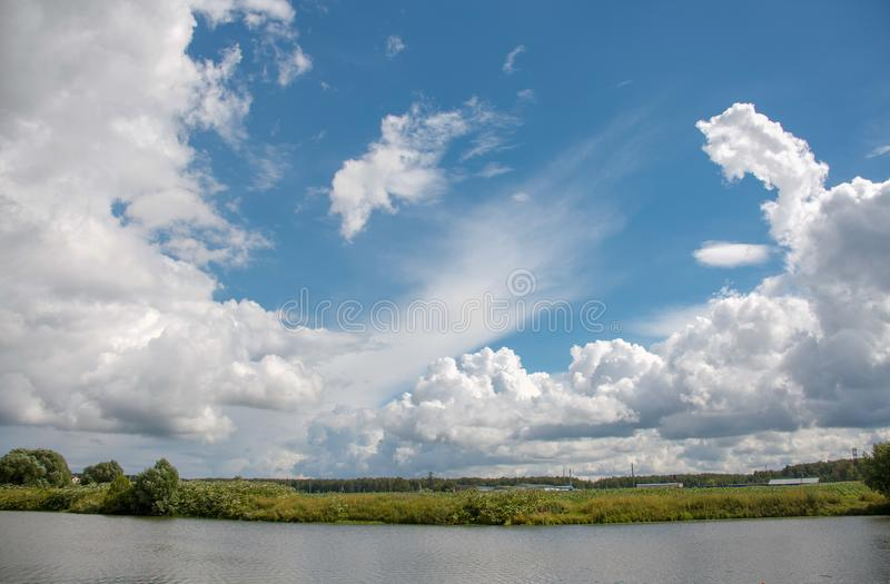 Beautiful sky full of clouds. Weekend in Russian countryside: Beautiful sky full of clouds royalty free stock photography