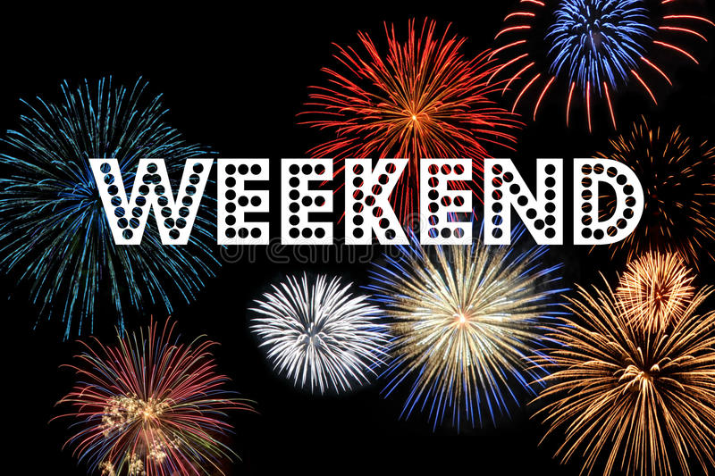 Weekend. The word weekend on a black background filled with fireworks royalty free stock photo