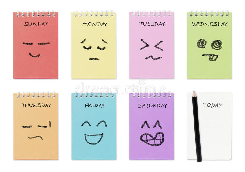Weekly calendar with face drawing. Routine work concept royalty free stock photography