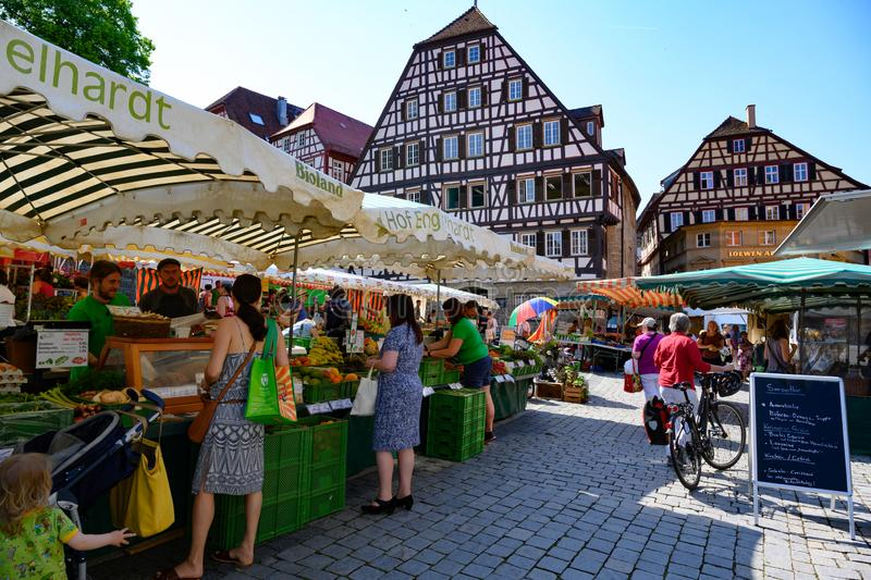 Weekly market in front of ancient historic houses, half timbered houses of Schwabisch Hall, Baden-Wuerttemberg, Germany. royalty free stock photos
