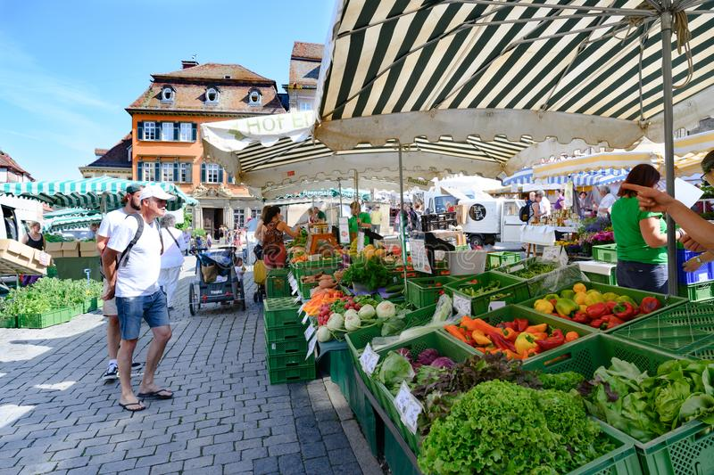 Weekly market in front of ancient houses of Schwabisch Hall, Baden-Wuerttemberg Schwabisch Hall, Germany. royalty free stock photography
