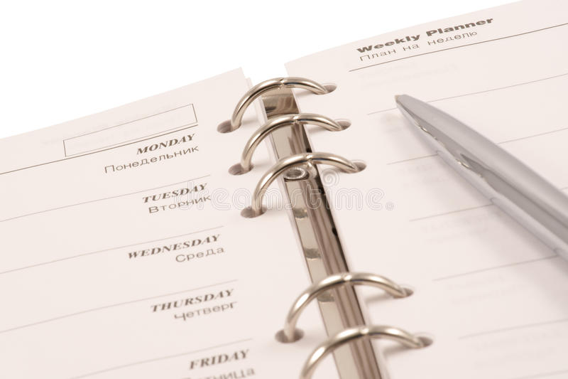 Weekly Planner And Pen (isolated) Stock Photography