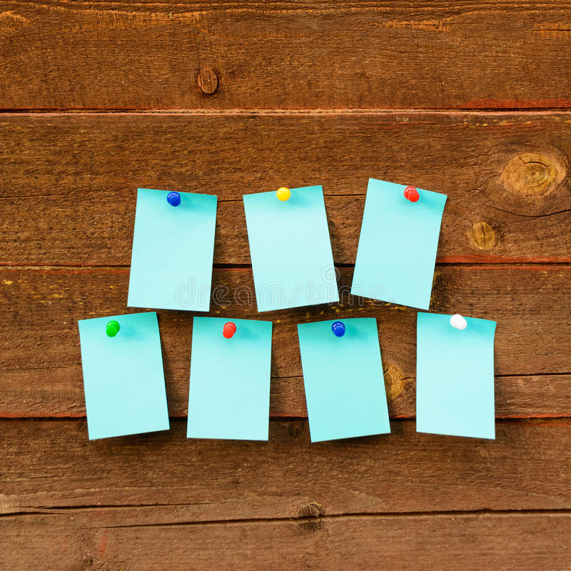 Weekly schedule with seven blue paper over wooden background stock image