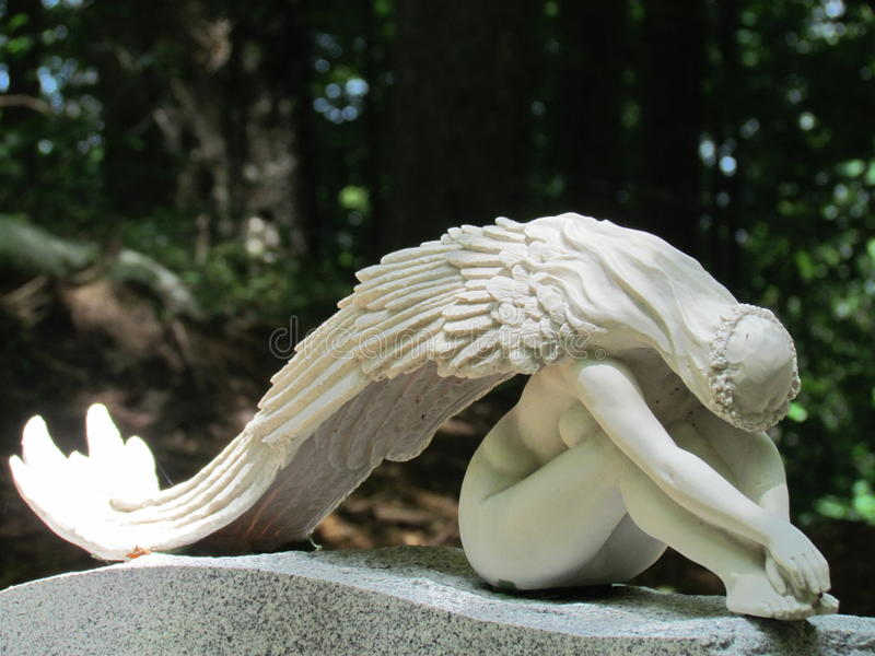 Weeping angel watching over those we love stock photography