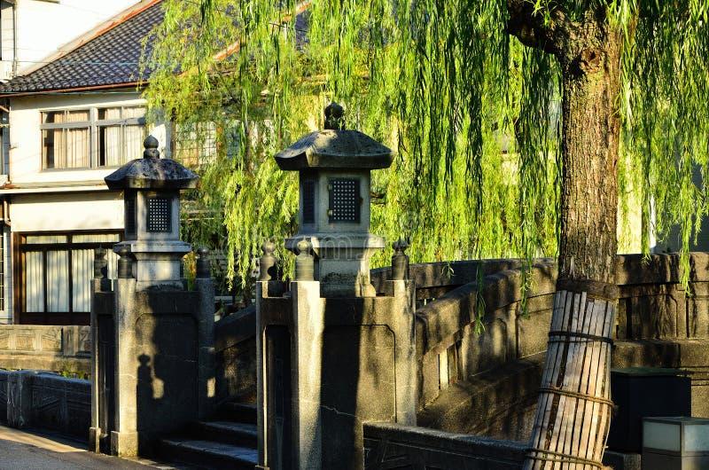 Weeping willow trees and bridge, Kinosaki Japan. royalty free stock photos