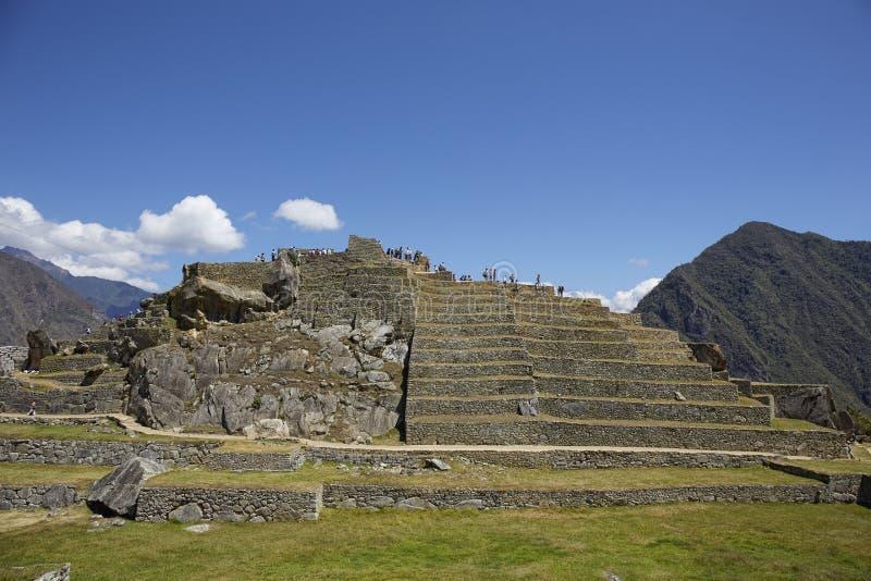 Weergeven van Machu Pichhu op een zonnige middag stock fotografie