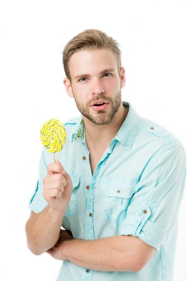 Weet u het De indrukwekkende voeding van de feiten schadelijke suiker Houdt de mensen knappe gebaarde kerel lollysuikergoed Mens  stock afbeelding