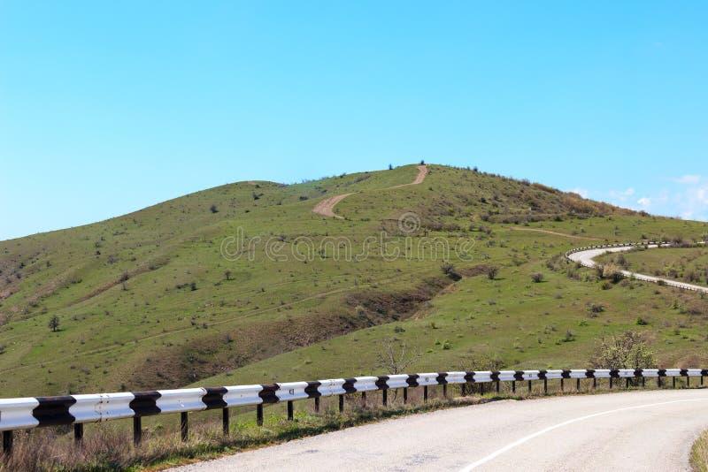 Weg aan bergen stock fotografie
