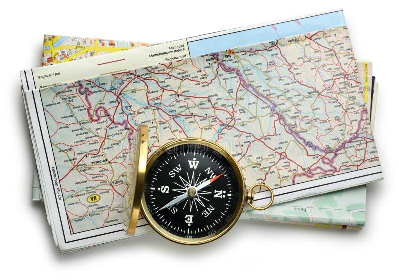 Wegenkaartplan en kompas stock afbeeldingen
