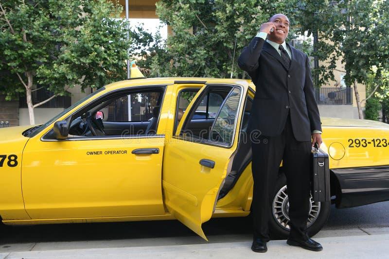 Weggaande Taxi de bedrijfs van de Mens stock fotografie