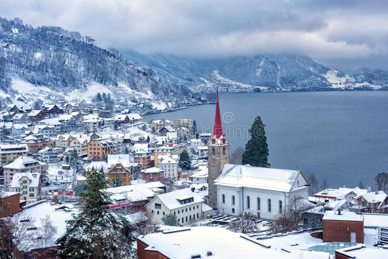 Weggis village on Lake Lucerne, swiss Alps mountains, Switzerland, in winter time. Weggis village on Lake Lucerne, swiss Alps mountains, Switzerland, covered stock images