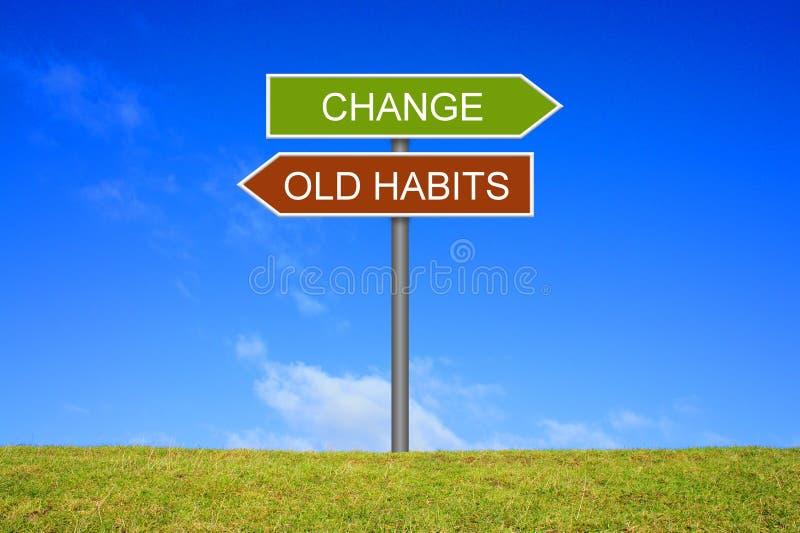 Wegweiser das Zeigen von alten Gewohnheiten und von Änderung lizenzfreie stockfotos