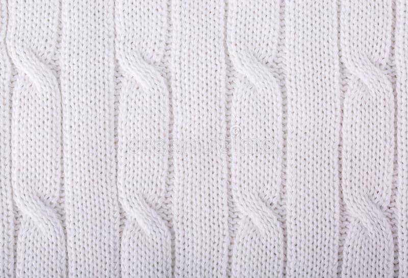 Weiß gestrickter Hintergrund lizenzfreies stockfoto
