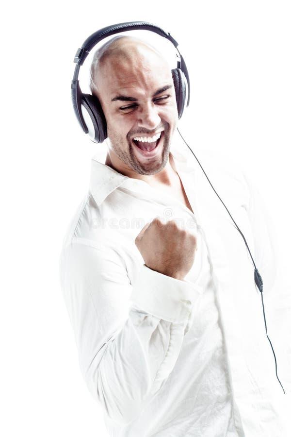 Weiß kleidete tragende Kopfhörer DJ und die Formung einer Faust stockbilder