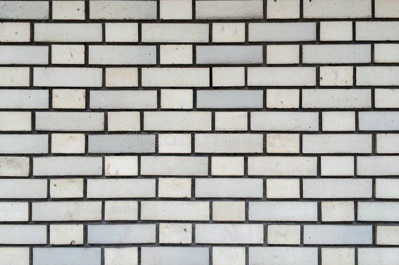 Weiße Backsteinmauer-nahtlose Muster-Hintergrund-Beschaffenheit für ununterbrochene Verdoppelung lizenzfreies stockfoto