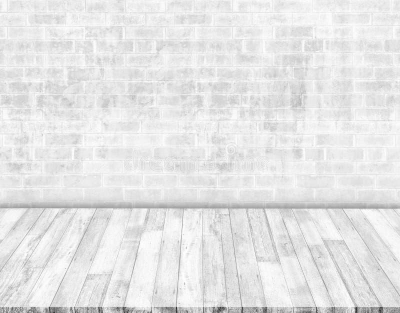 Weiße Backsteinmauern und weiße Holzfußböden lizenzfreie abbildung
