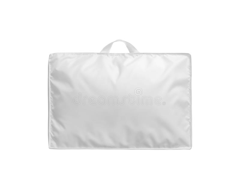 Weiße Daunendecke in der Tasche lokalisiert Daunendecke herein verpackt zur PVC-Tasche lizenzfreie stockfotografie