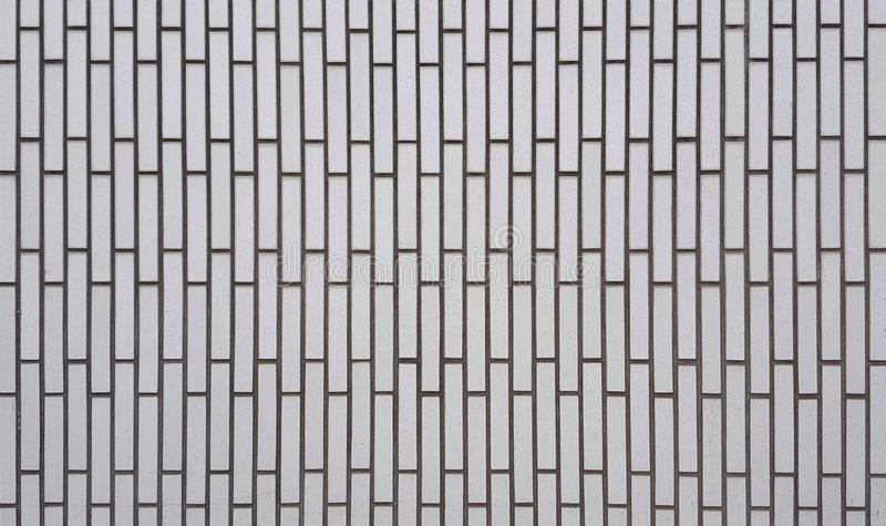Weiße Farbe der Wandfliesen sind in Form rechteckig stockfotografie